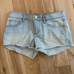 Juicy Couture light wash cut off denim shorts